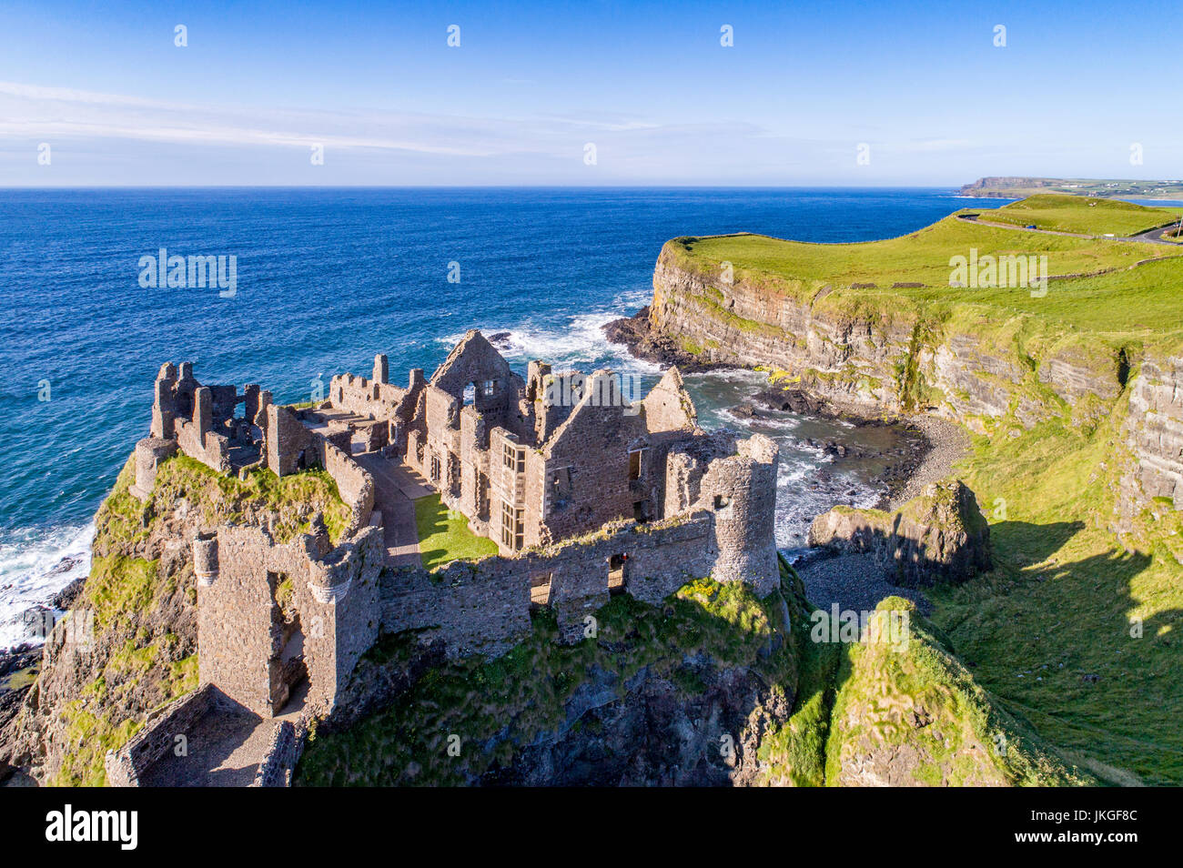 Ruins of medieval Dunluce Castle, cliffs, bays and peninsulas. Northern coast of County Antrim, Northern Ireland, - Stock Image