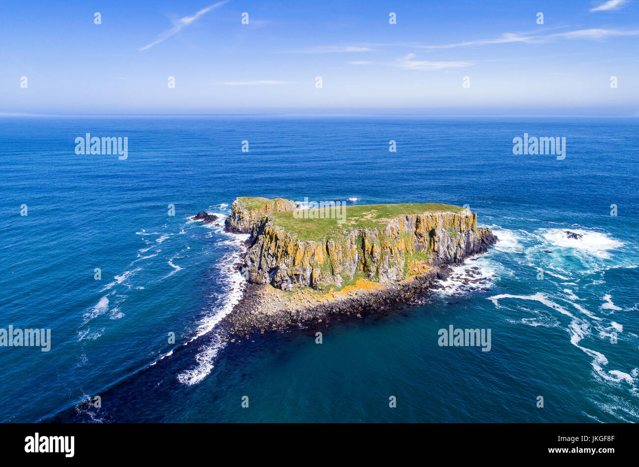 The Sheep Island near Ballintoy, Carrick-a-Rede and Giant's Causeway, North Antrim Coast, County Antrim, Northern - Stock Image