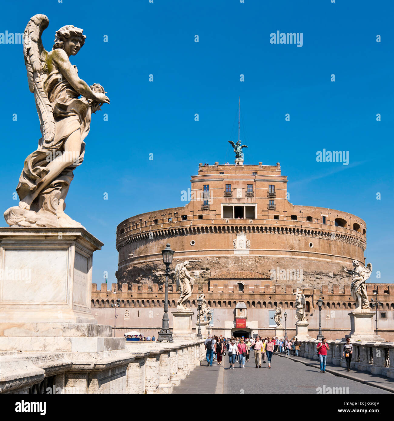Square view of an Angel statue adorning the bridge towards Castel Sant'Angelo in Rome. - Stock Image