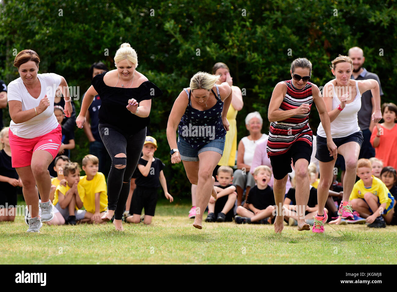 Mum's race event at an infant school sports day, Bordon, Hampshire, UK. 14 July 2017. - Stock Image