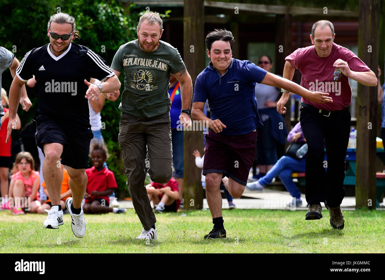 Fathers' race event at an infants school sports day, Bordon, hampshire, UK. 14 July 2017. - Stock Image