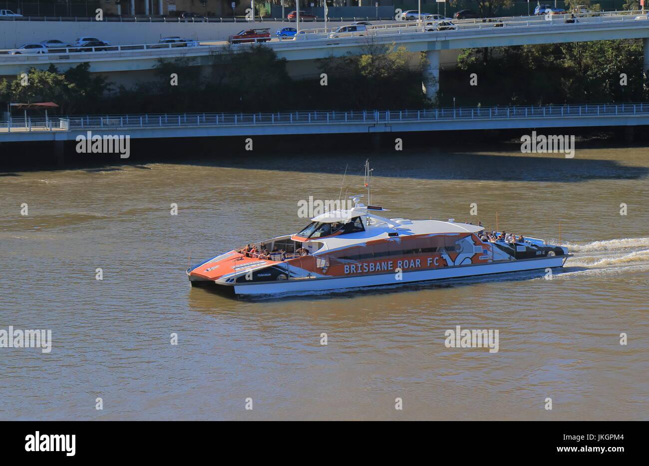 Sightseeing cruise boat Citycat sails on Brisbane river in downtown Brisbane Australia. - Stock Image