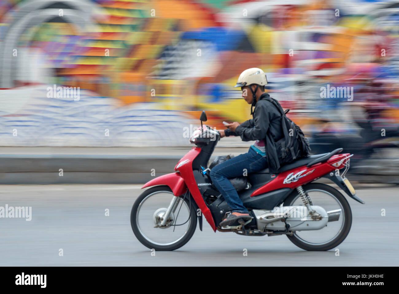 Street scene with motorbike Hanoi Vietnam - Stock Image