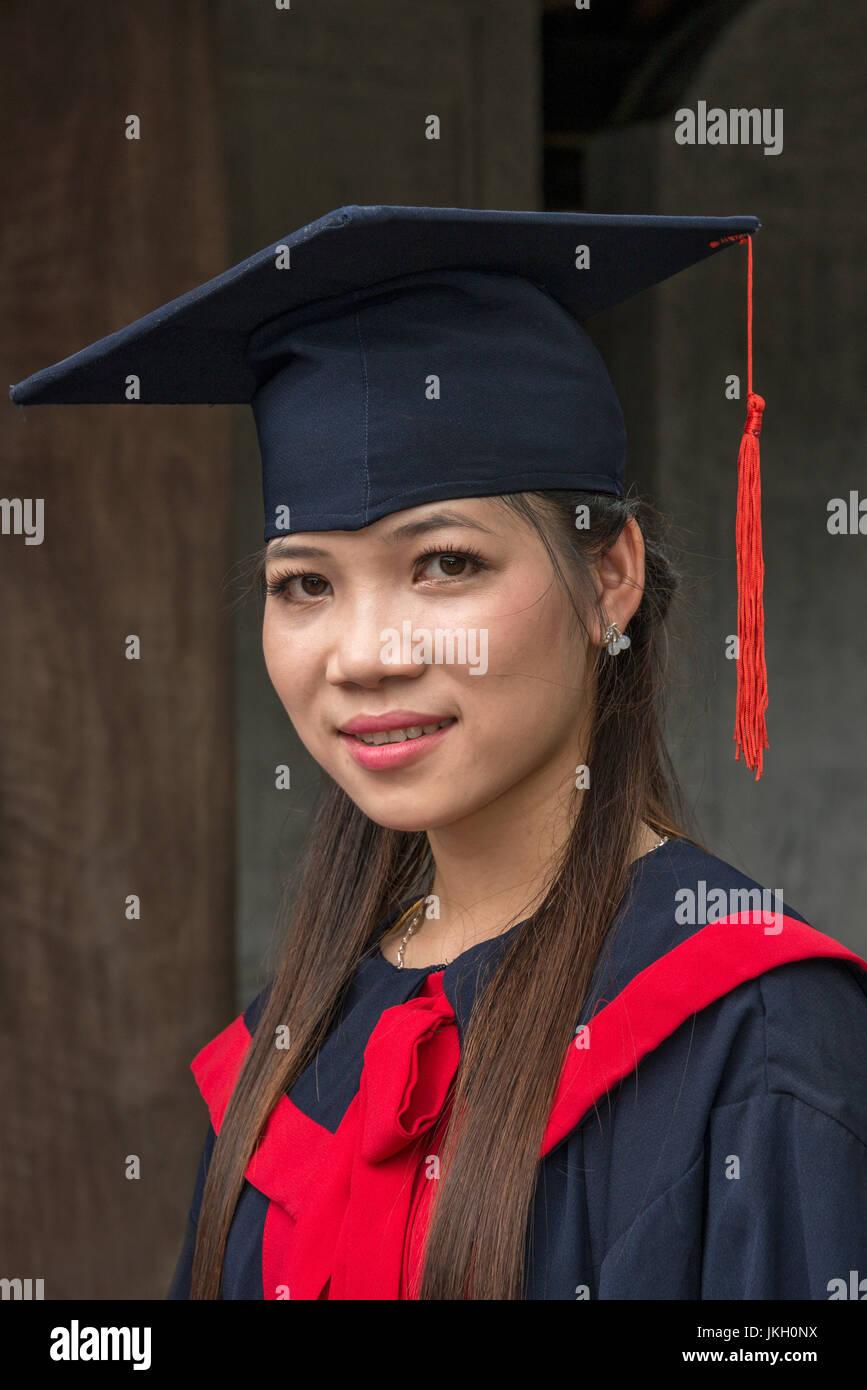 Young Vietnamese graduate Temple of Literature, Hanoi, Vietnam - Stock Image