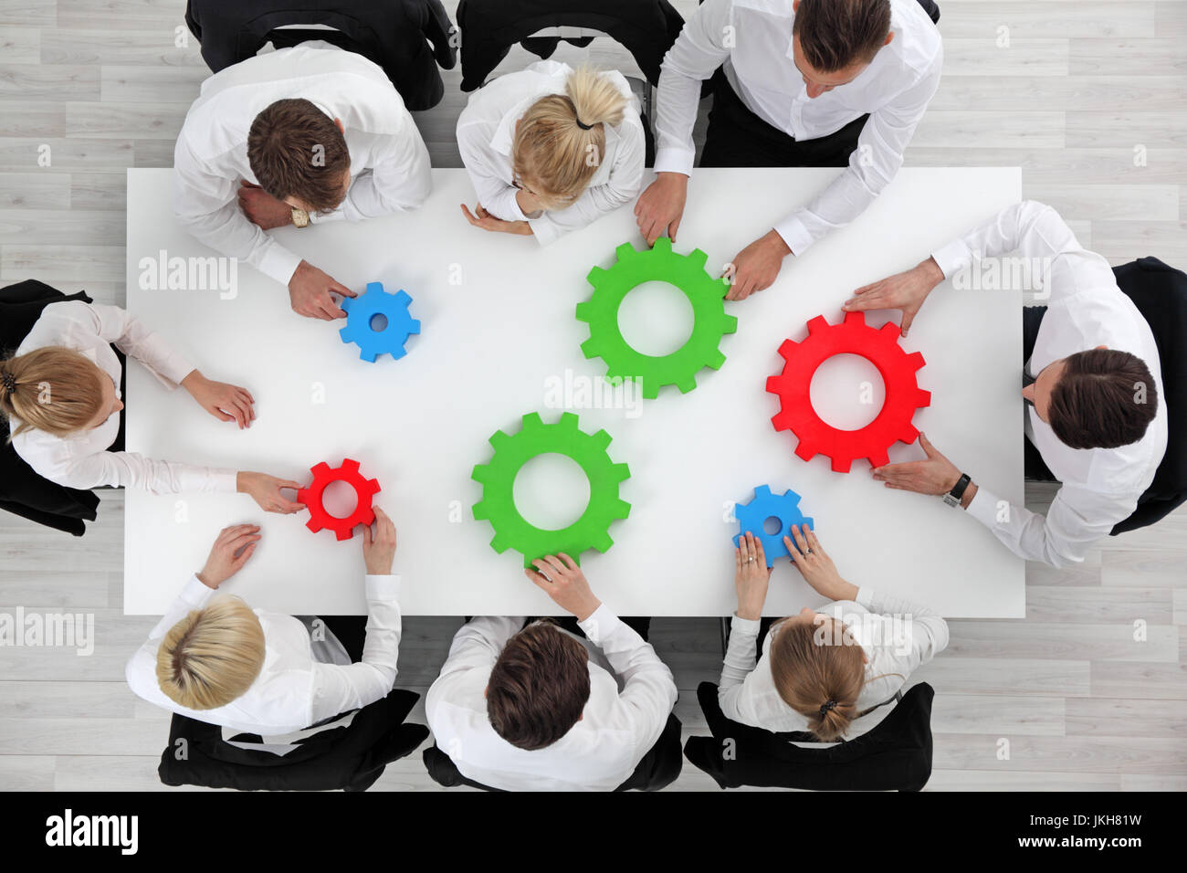 Business problem solution, mechanism of business, teamwork concept, business team sitting around white table with - Stock Image