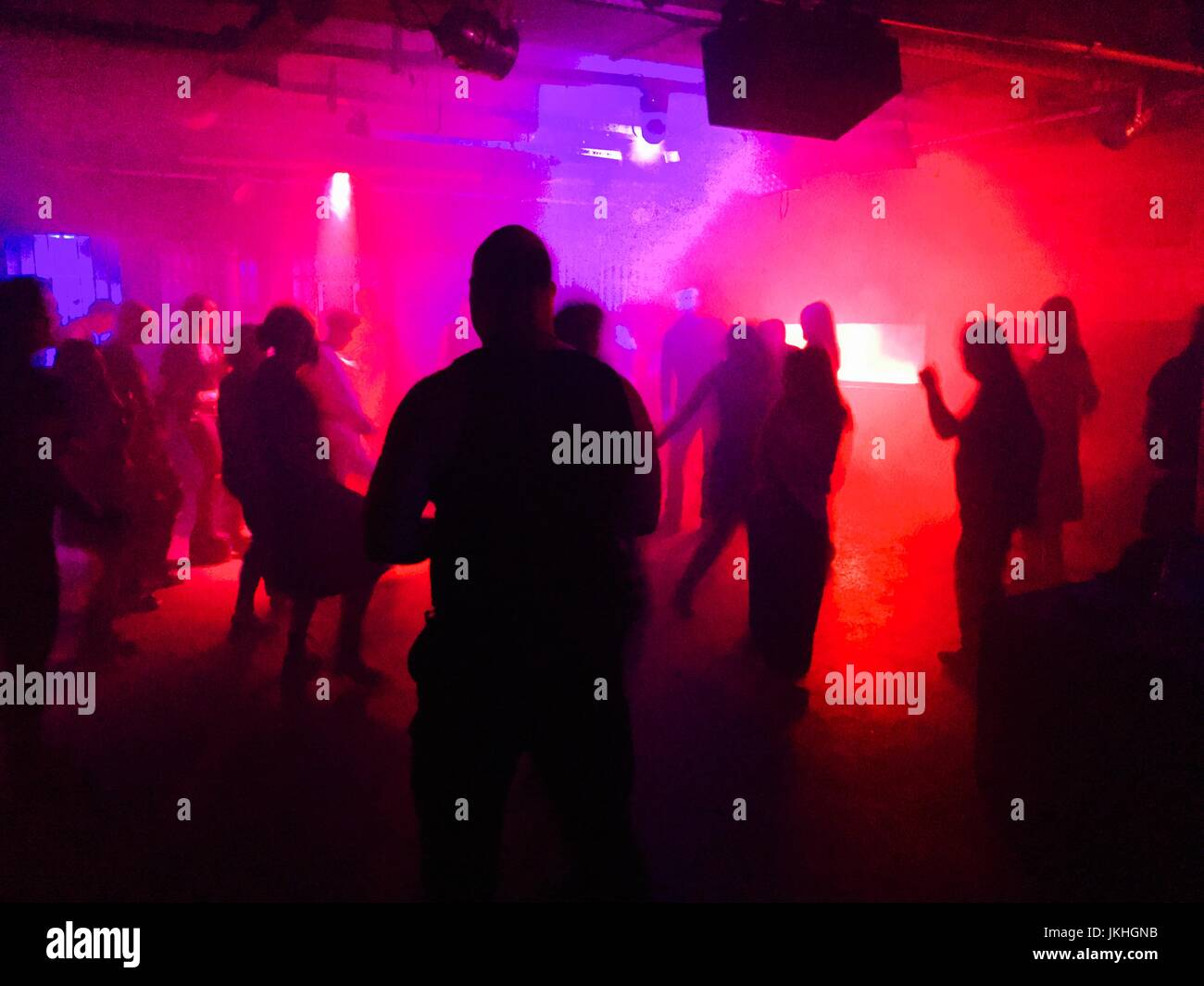 Young people dancing in club - Stock Image