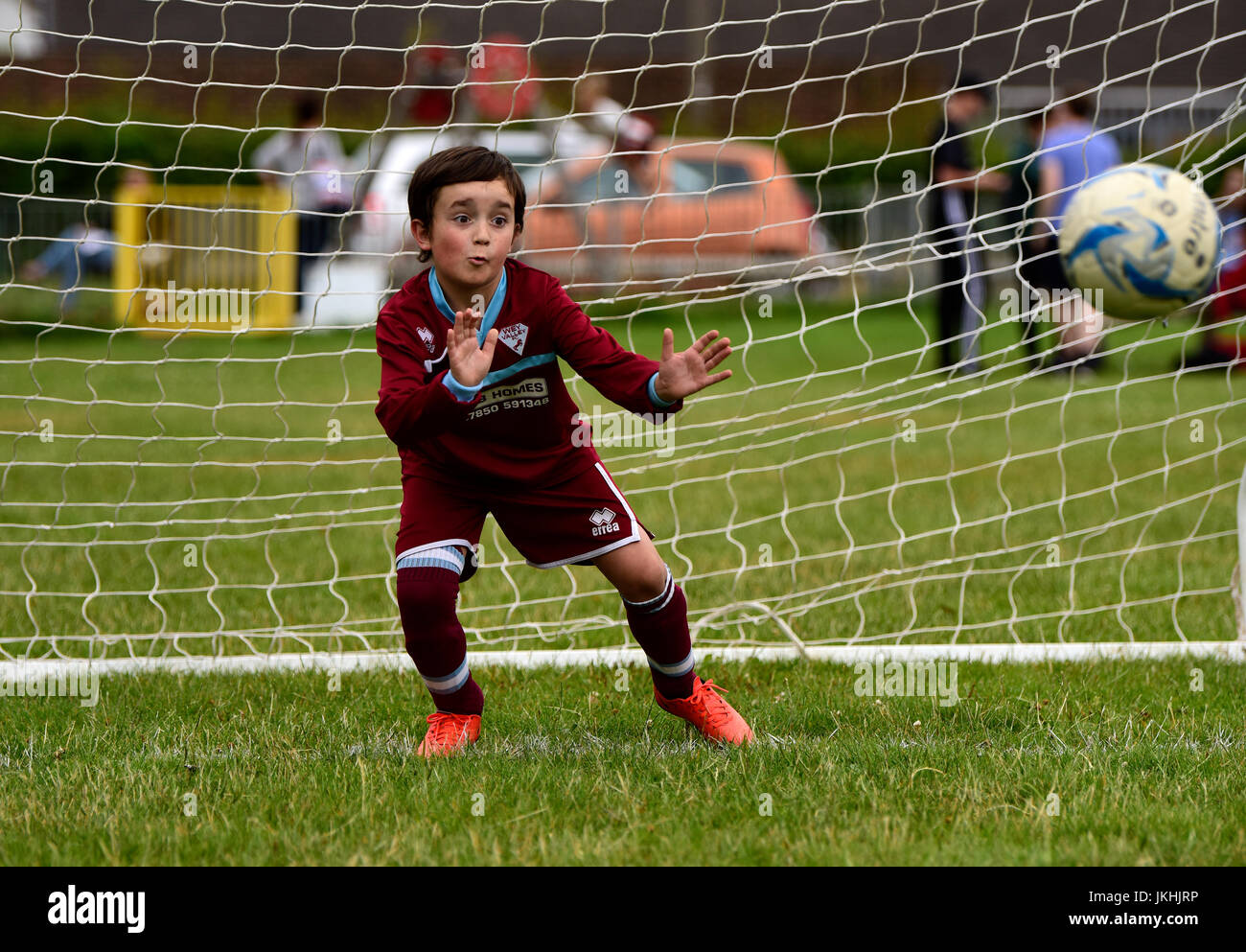 Goalkeeper attempting to save a penalty during an Under 10 years penalty shootout competition, Bordon, Hampshire, - Stock Image
