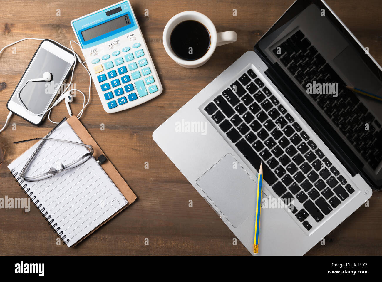 office desk laptop computer notebook mobile. Office Desk Table With Laptop, Calculator, Smartphone, Pencil And Notebook.Flat Lay Photo.Top View Working Concept. Laptop Computer Notebook Mobile N