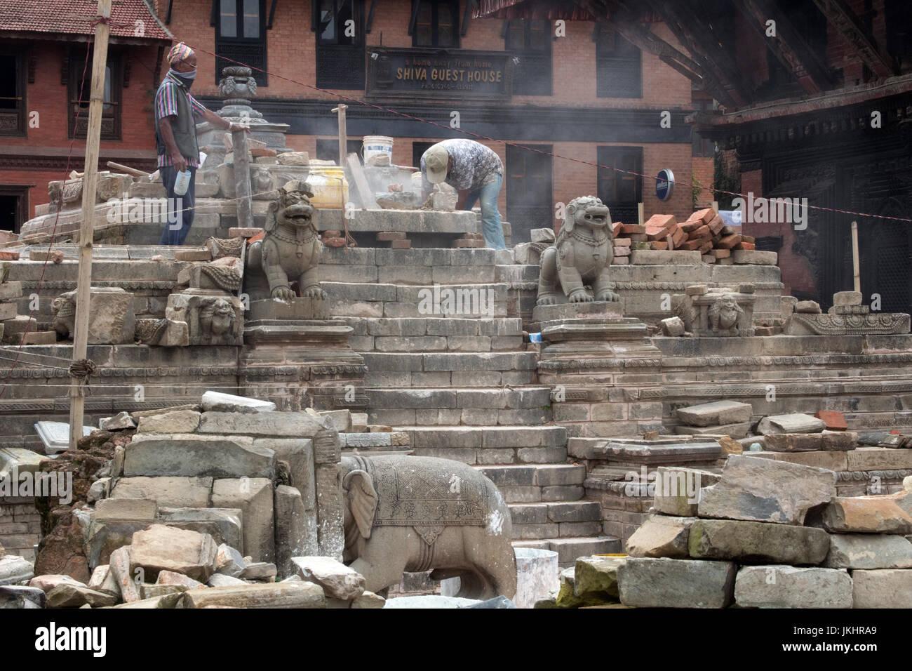 Workmen restoring and rebuilding the earthquake damaged Vatsala Durga Temple or Vatsala Devi Temple Bhaktapur Kathmandu - Stock Image