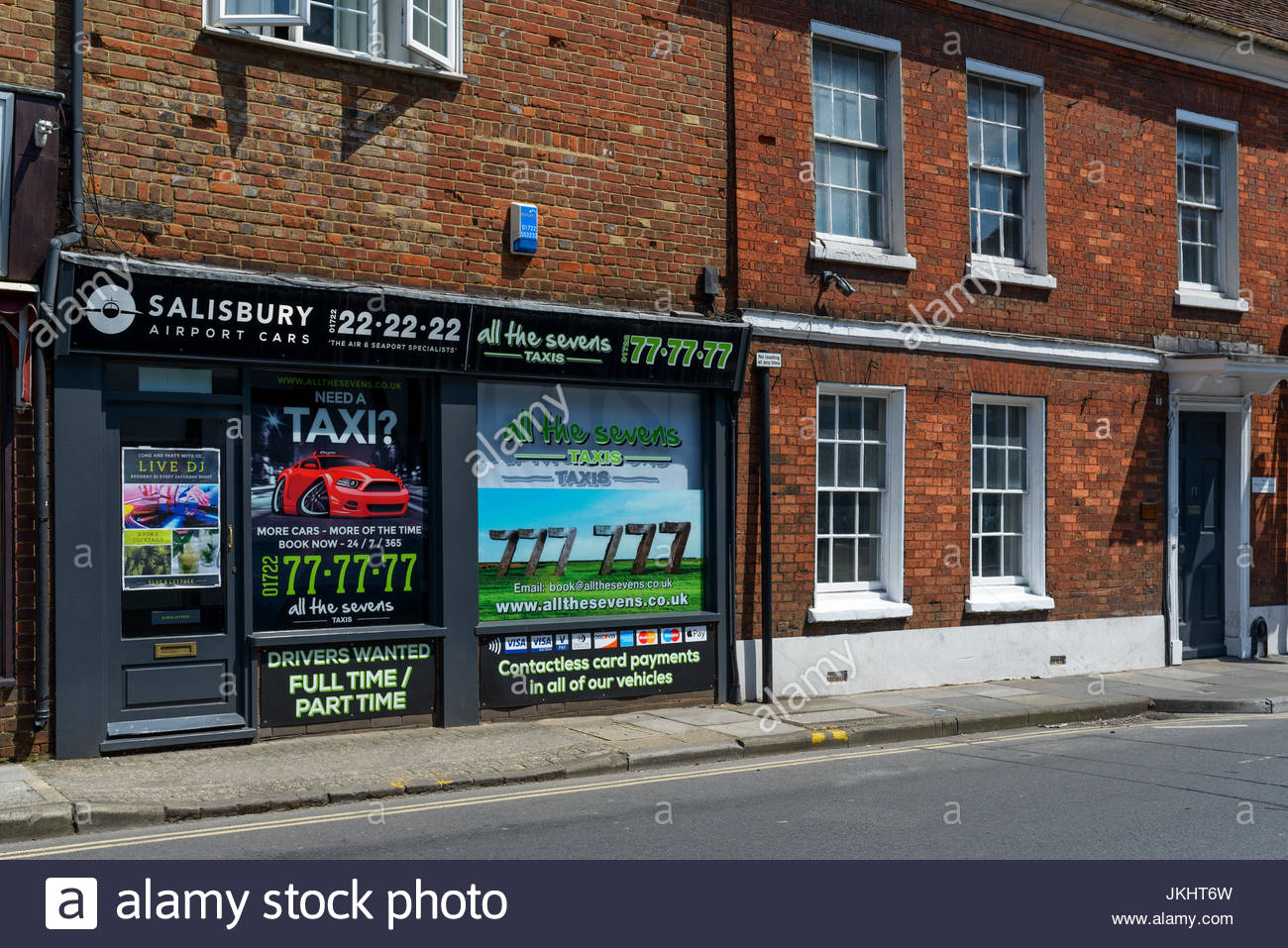 All the Sevens taxi office, Salisbury, Wiltshire, England UK Stock Photo