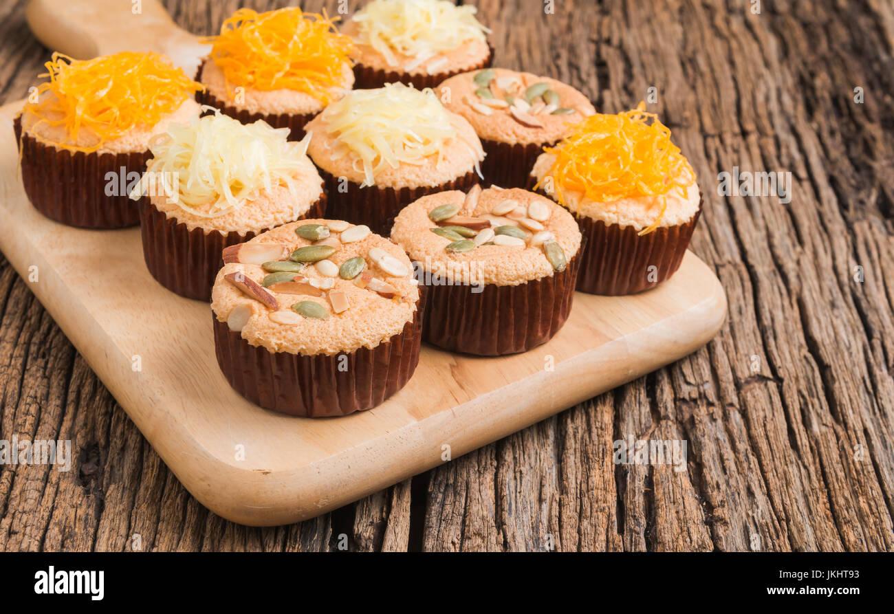 mamon cake or cupcake on wood background - Stock Image