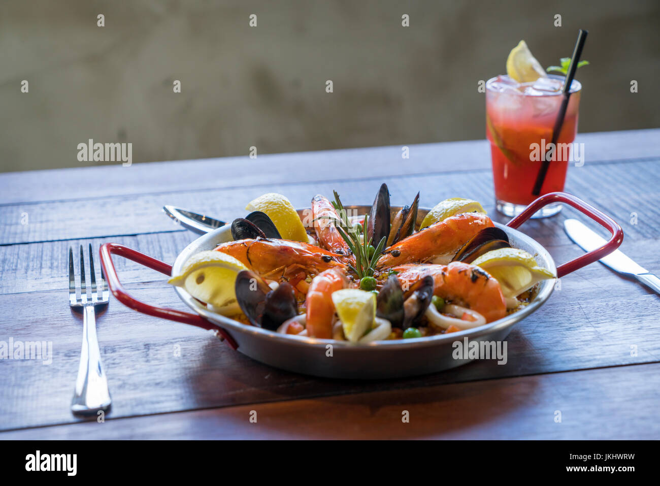 Paella with seafood vegetables and saffron served in the traditional pan. - Stock Image
