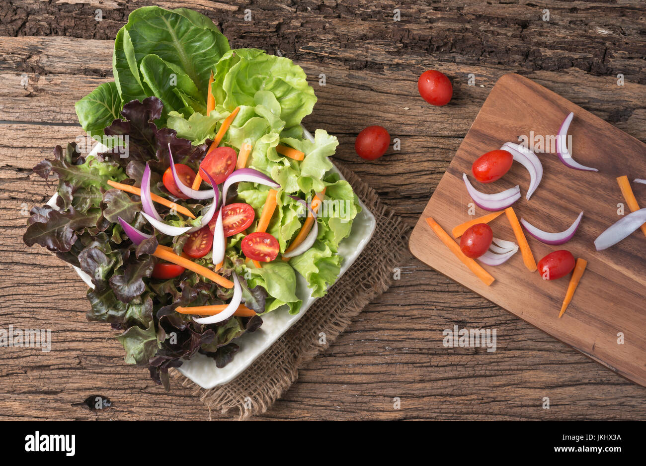 Red Oak and Green Oak salad and fresh vegetables  on wood background - Stock Image