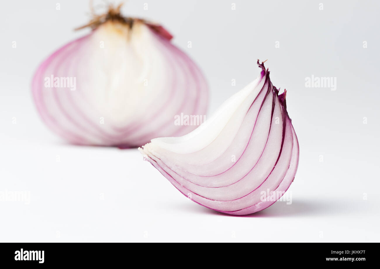 Sliced fresh shallot or onion on white background - Stock Image