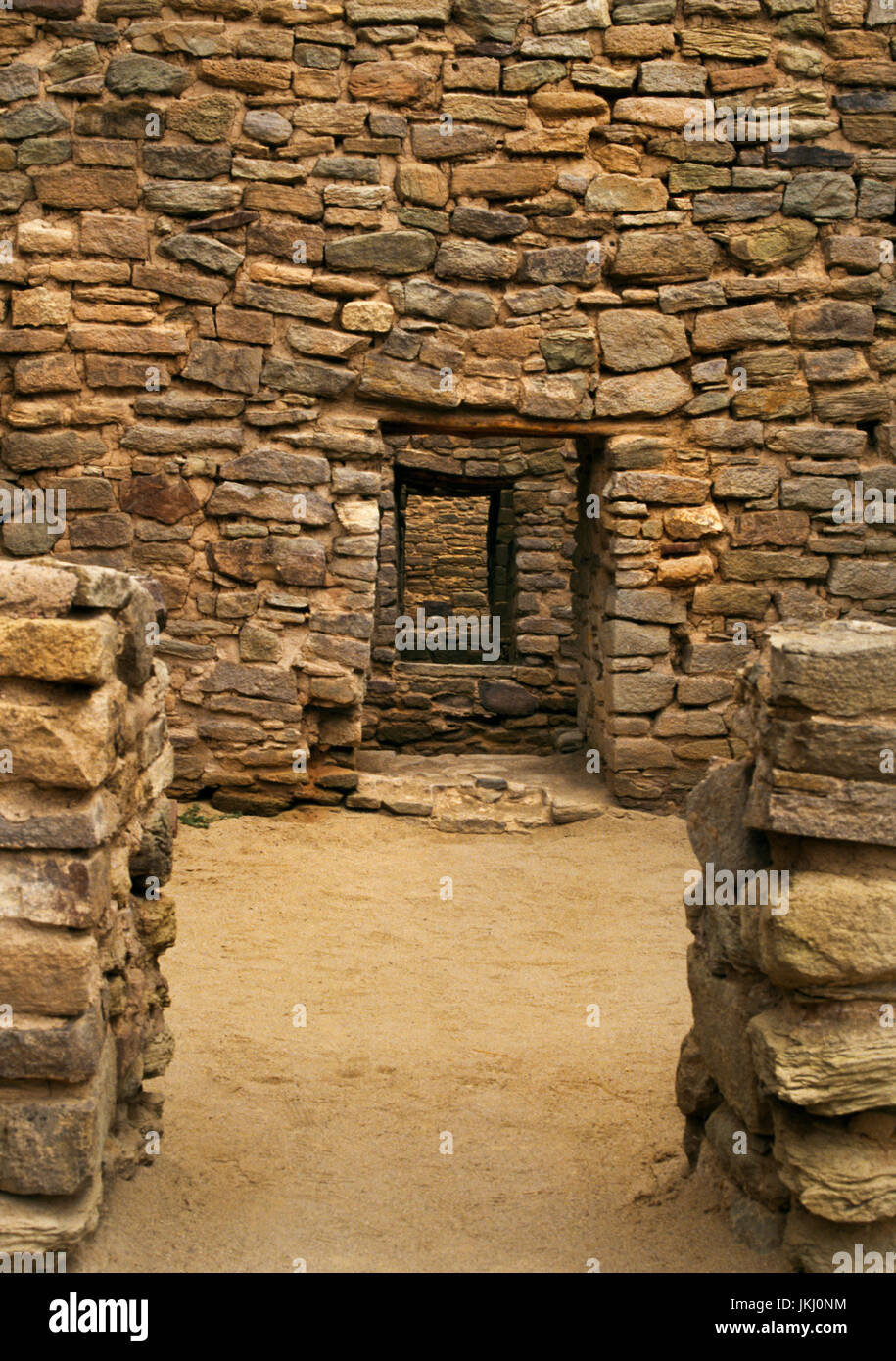 A series of doorways in the eastern multi-storey room block of Aztec Ruins pueblo, New Mexico: note the high sills - Stock Image