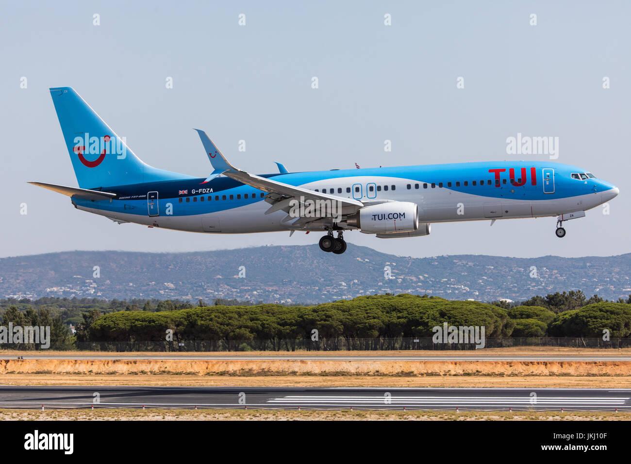 FARO, PORTUGAL - Juny 18, 2017 : Tui Flights aeroplane landing on Faro International Airport. Airport - Stock Image