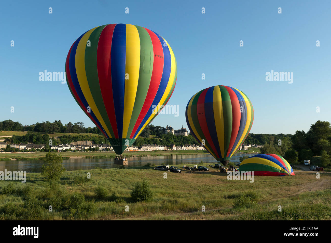 striped hot air baloons in front of chaumont sur loire, france Stock Photo