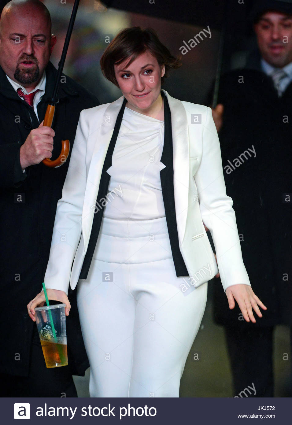 bf14d23f9310 Lena Dunham steps out wearing a white suit on a rainy day in New York City  following an interview on  Good Morning America  in Times Square.