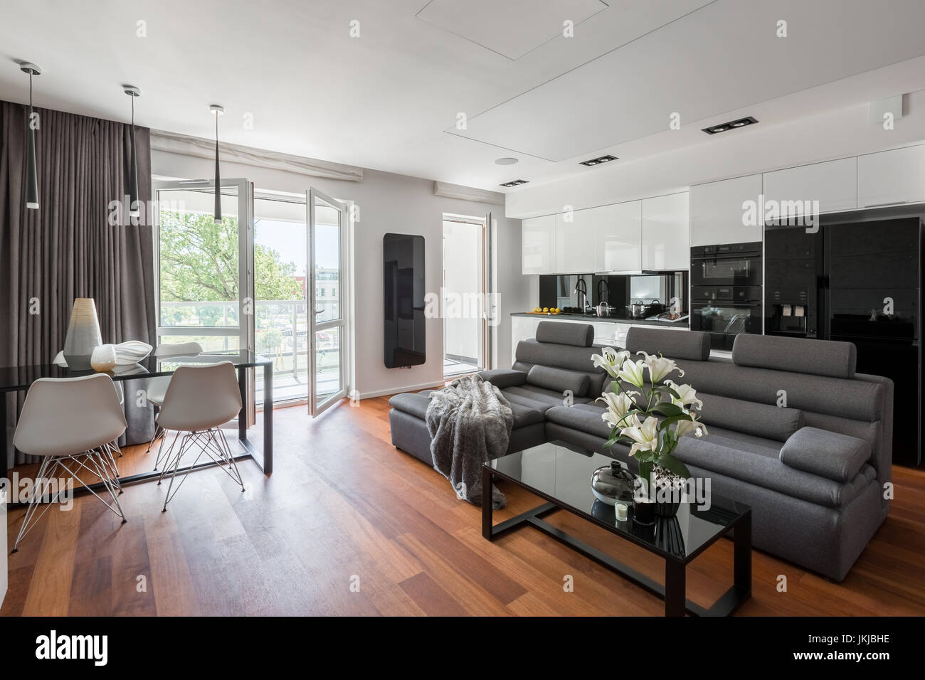 Contemporary Living Room With Gray Sofa Table And Balcony