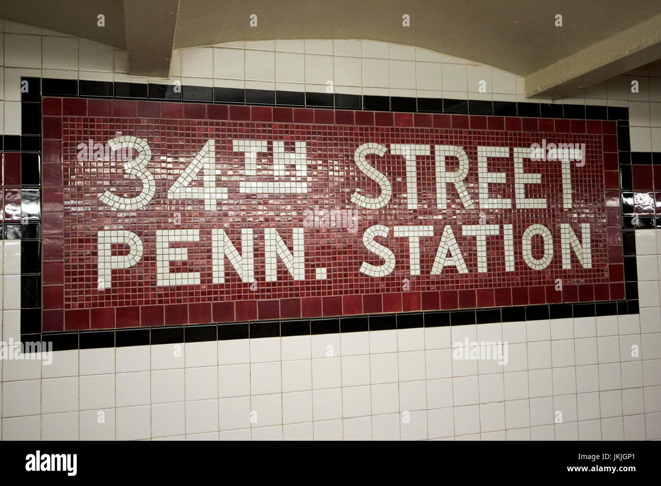 Mosaic old style subway station sign 34th street penn station new york city usa stock