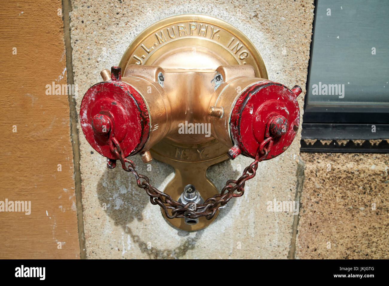 polished brass metal standpipe dry riser on apartment building New York City USA - Stock Image