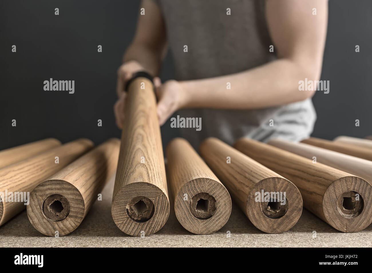 Man taking wooden billet - Stock Image