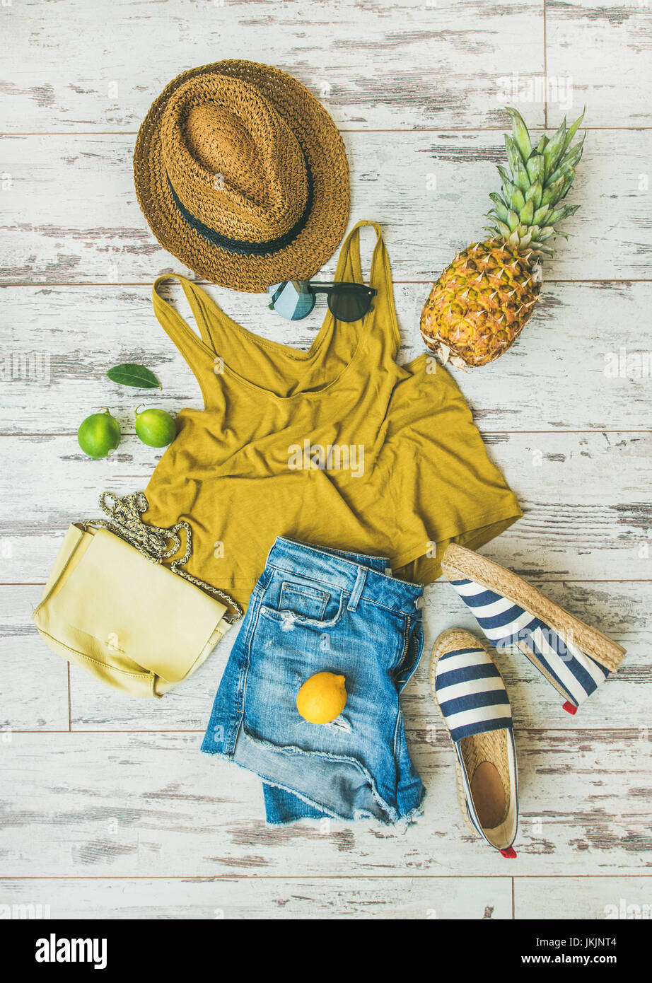 Colorful summer fashion outfit flat-lay over pastel background - Stock Image