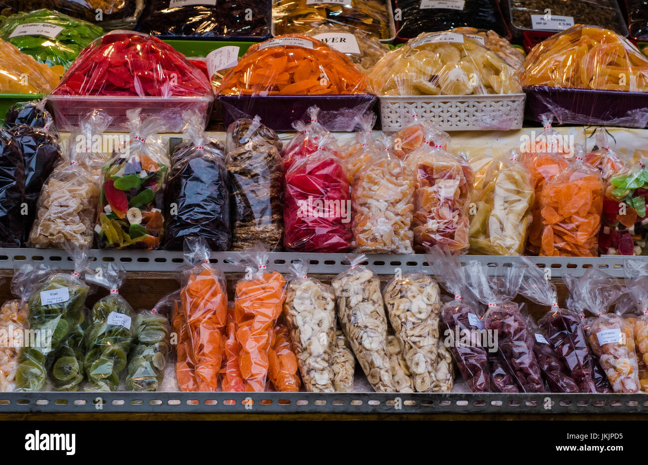Colourful sweets and candy packaged in individual bags on display for  sale in street market stall Stock Photo