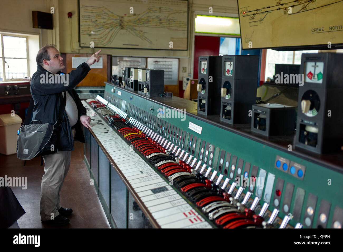 An enthusiast working out which levers to operate at Crewe heritage centre - Stock Image