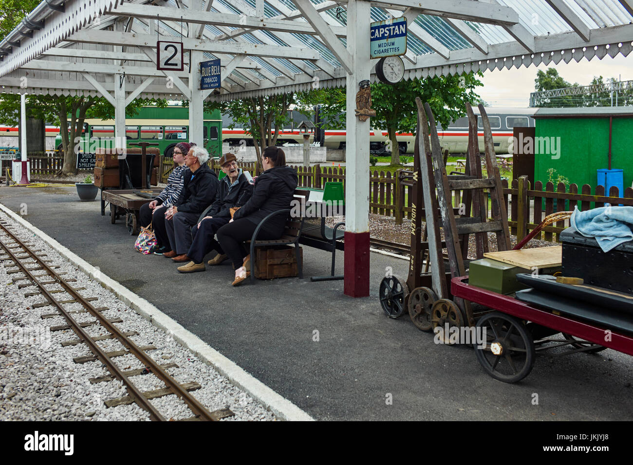 People waiting for miniature train at Crewe railway heritage centre - Stock Image