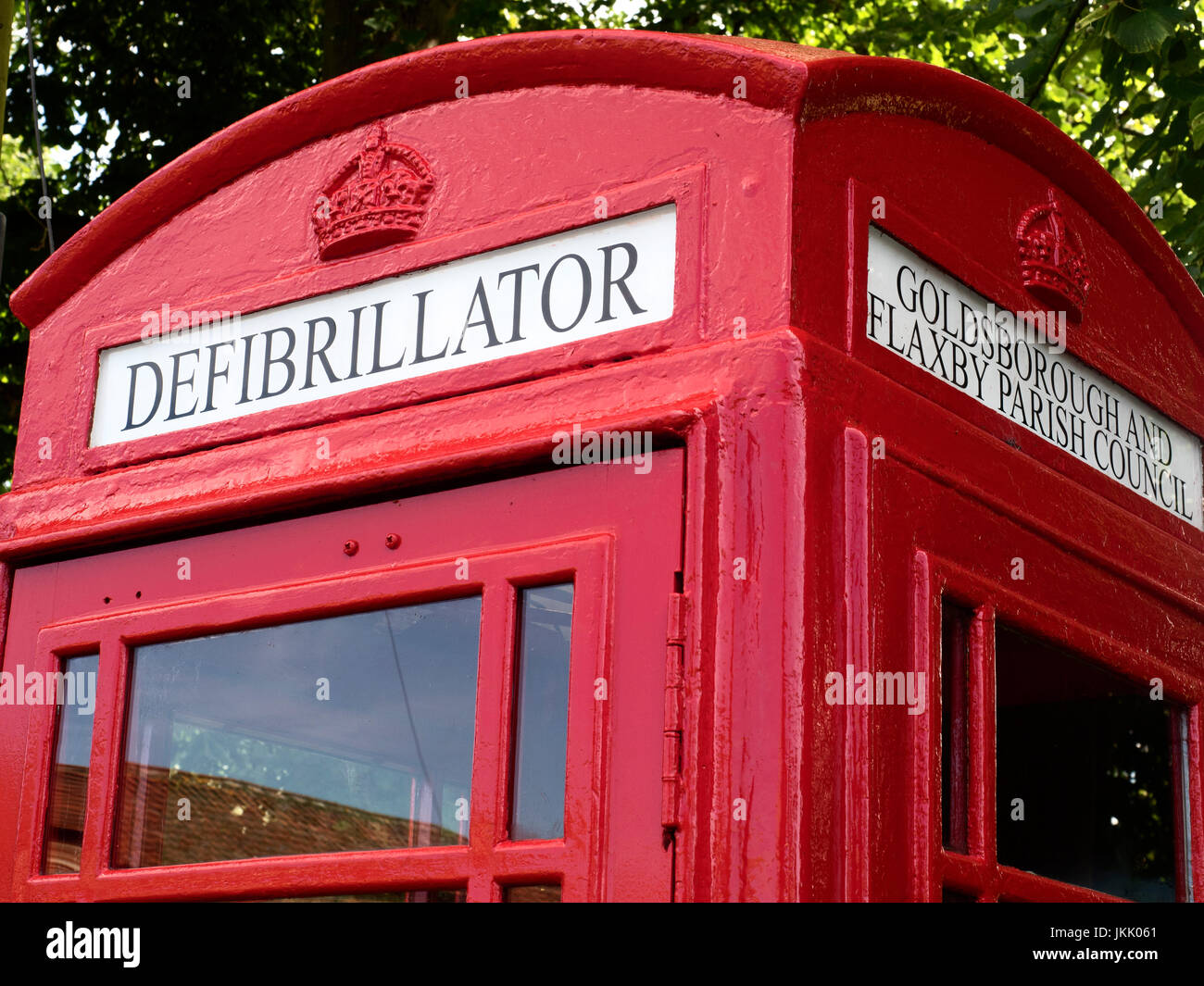 Defibrillator Sign in an Old K6 Red Telephone Box at Goldsborough near Knaresborough North Yorkshire England - Stock Image