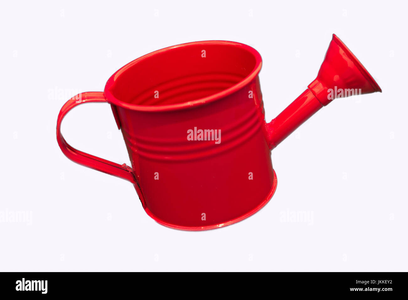 Single Red Watering can Isolated on white Background. Image is clean and bright and centred in the image with room - Stock Image