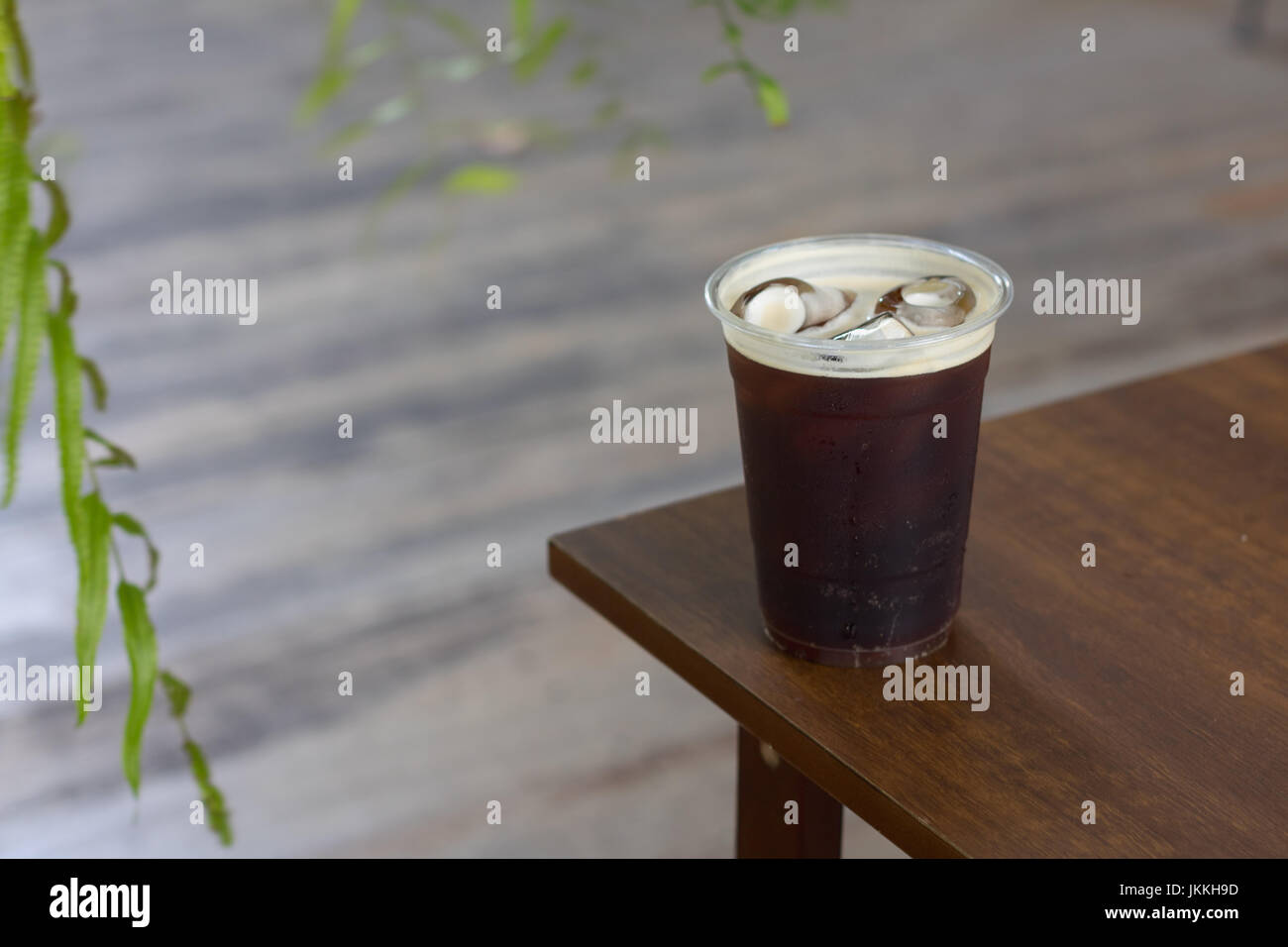 Sparkling Nitro Cold Brew Coffee on table outdoor cafe ready to drink - Stock Image