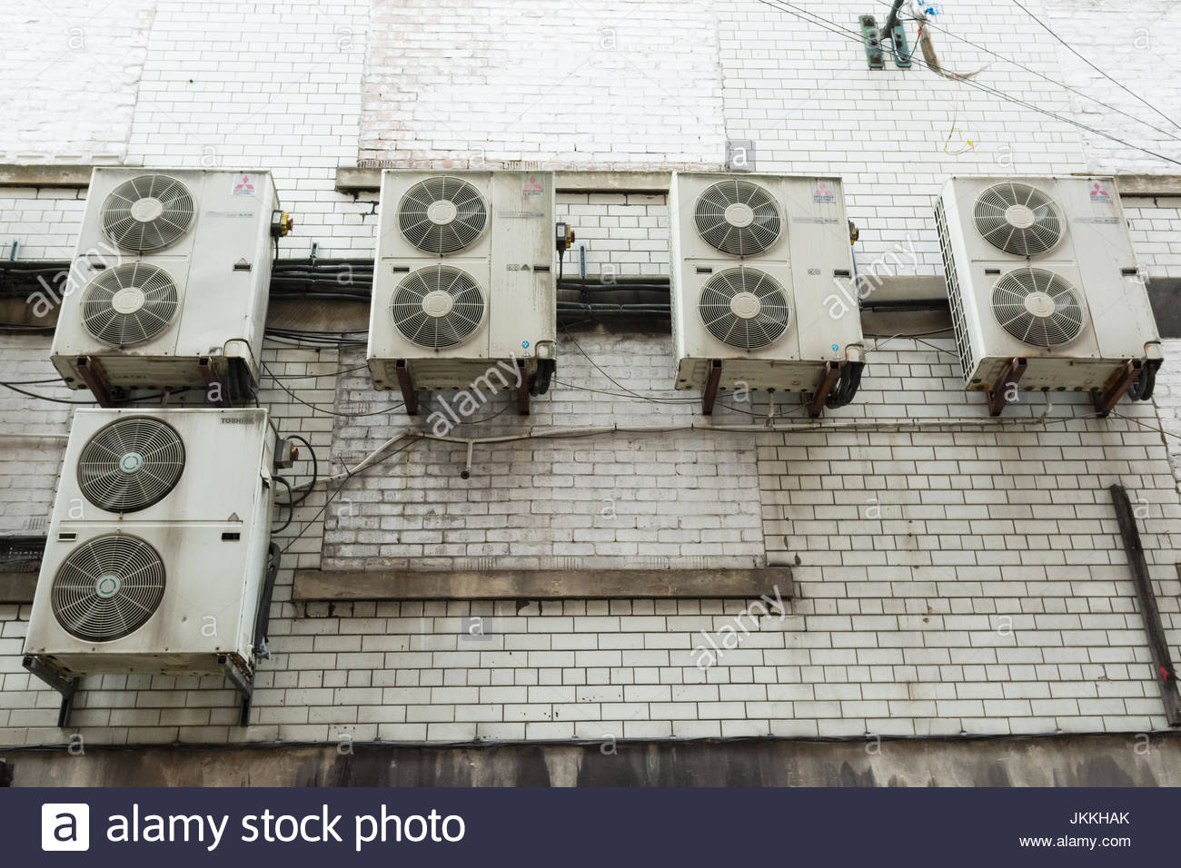air conditioning units on external wall - Stock Image
