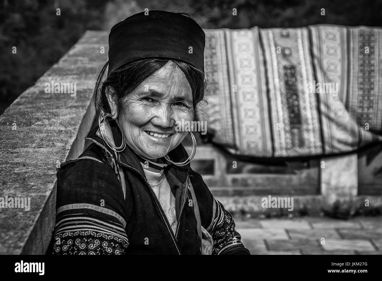 Elderly woman selling clothes in a market - April 2017 - Stock Image