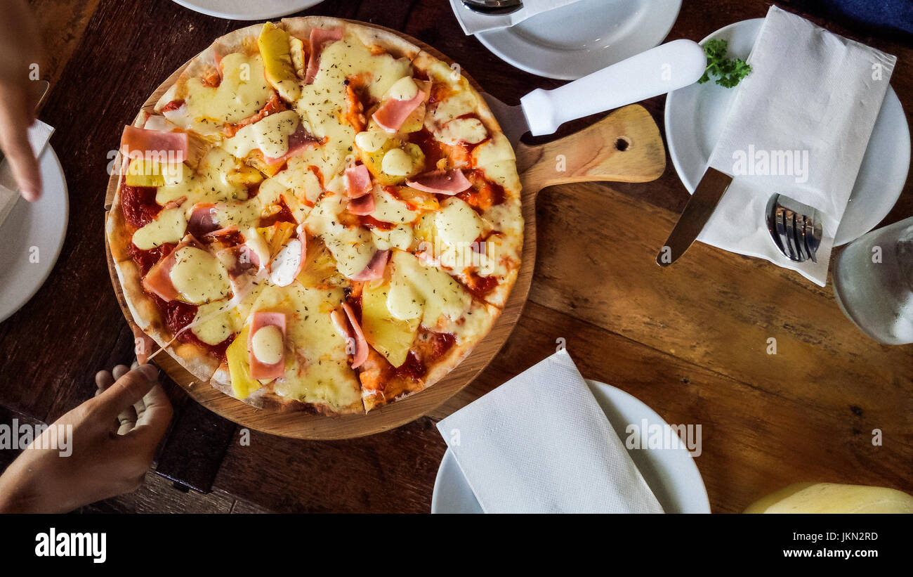 Meat Hawaiian Pizza Fast Food On Wooden Background - Stock Image