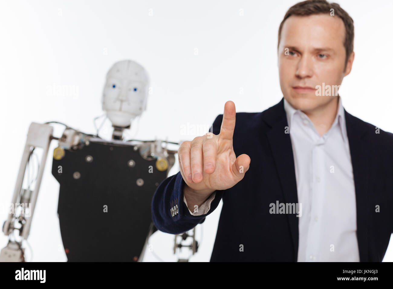 Serious handsome man tapping on a screen - Stock Image