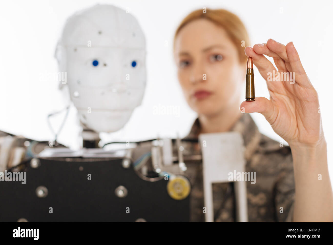 Ambitious confident officer using technology for military purposes - Stock Image