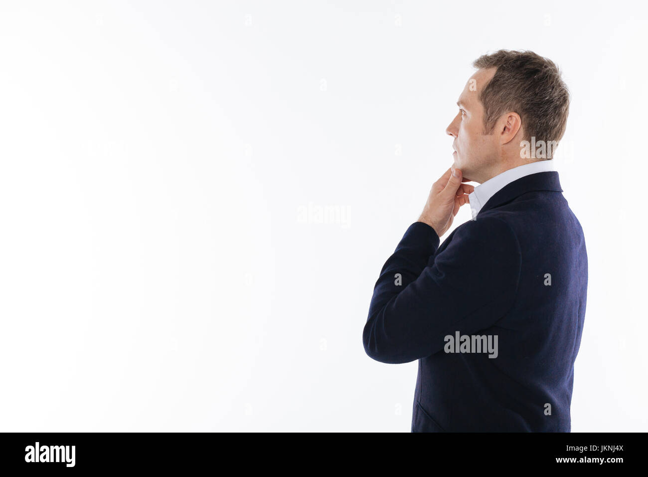 Charming intelligent gentleman acting during the photoshoot - Stock Image