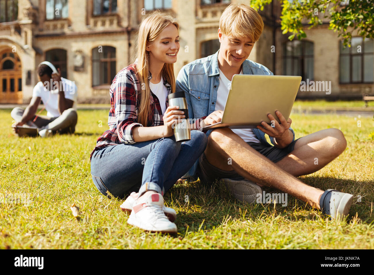 Two committed students studying for the finals together - Stock Image