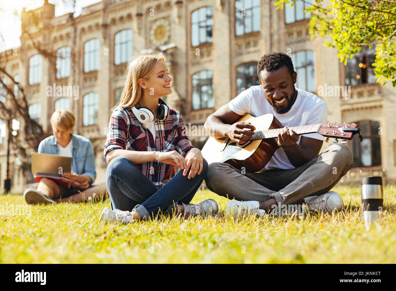 Artistic positive man trying impressing his friend - Stock Image