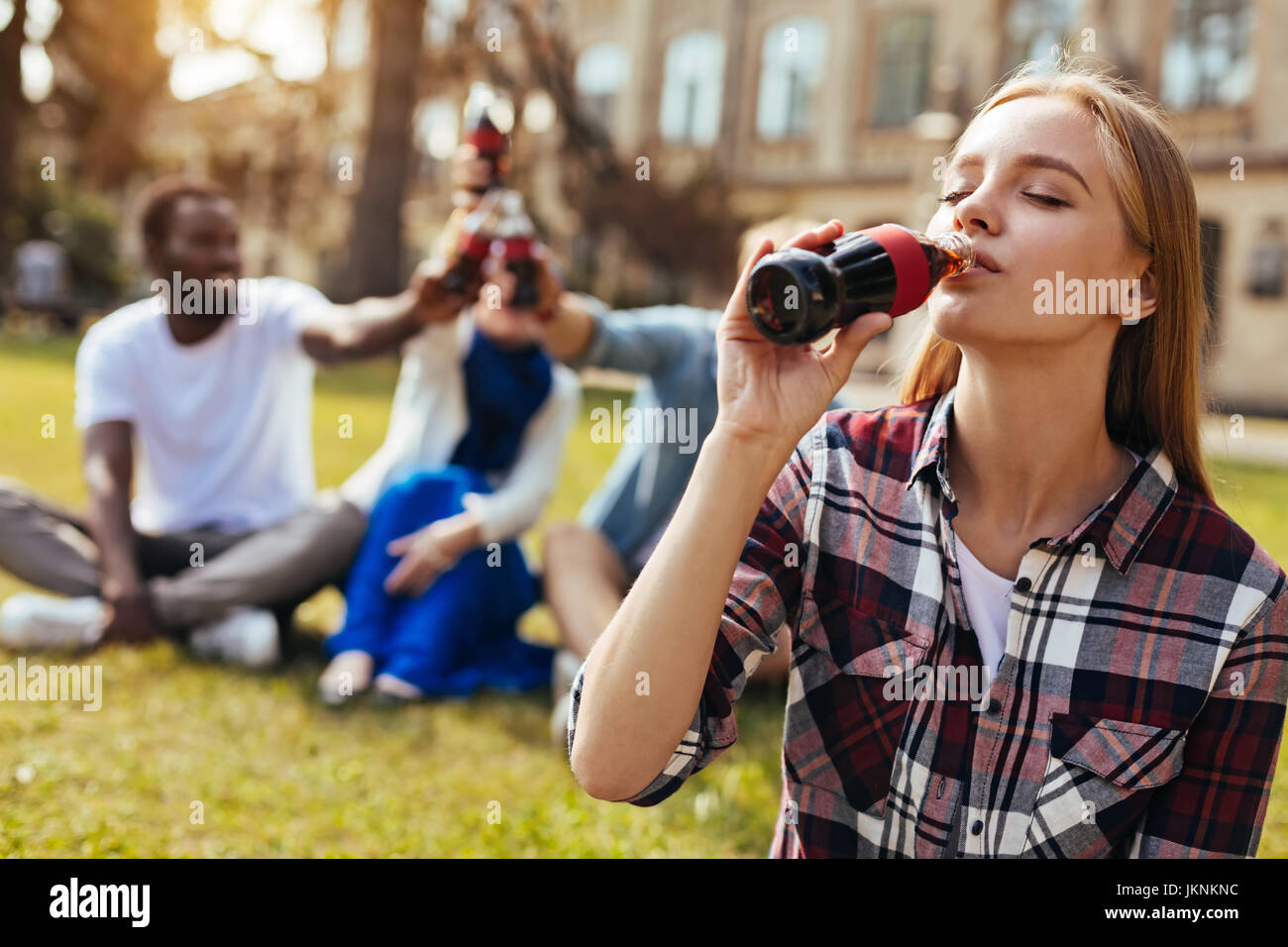 Gorgeous classy girl quenching her thirst - Stock Image