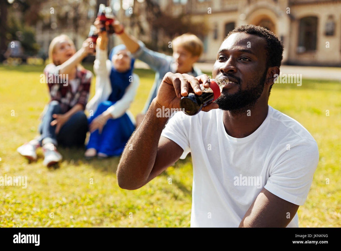 Attractive outgoing guy allaying thirst Stock Photo