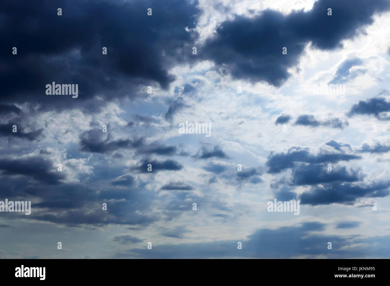 A blue sky with storm clouds. Before the rain.; - Stock Image