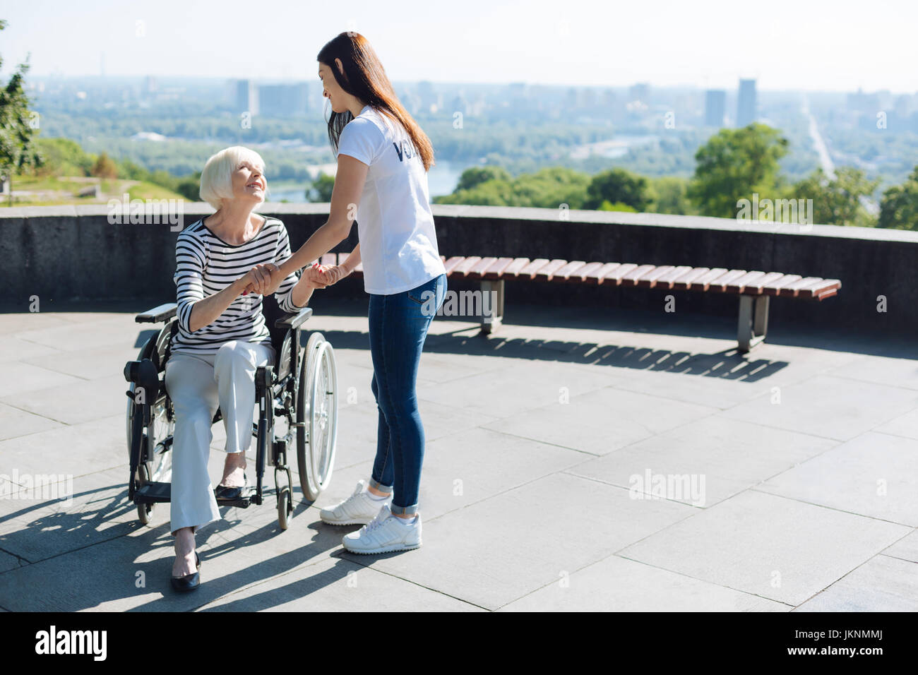 Bright stunning lady thankful for volunteers support - Stock Image