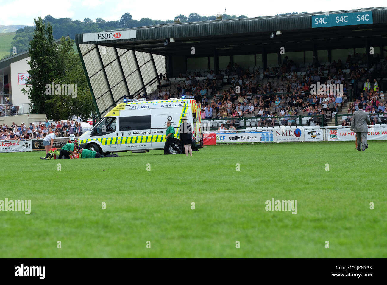 Royal Welsh Show - Monday 24th July 2017 - The Kangaroo Kid motorcycle stuntman is treated by ambulance staff after - Stock Image
