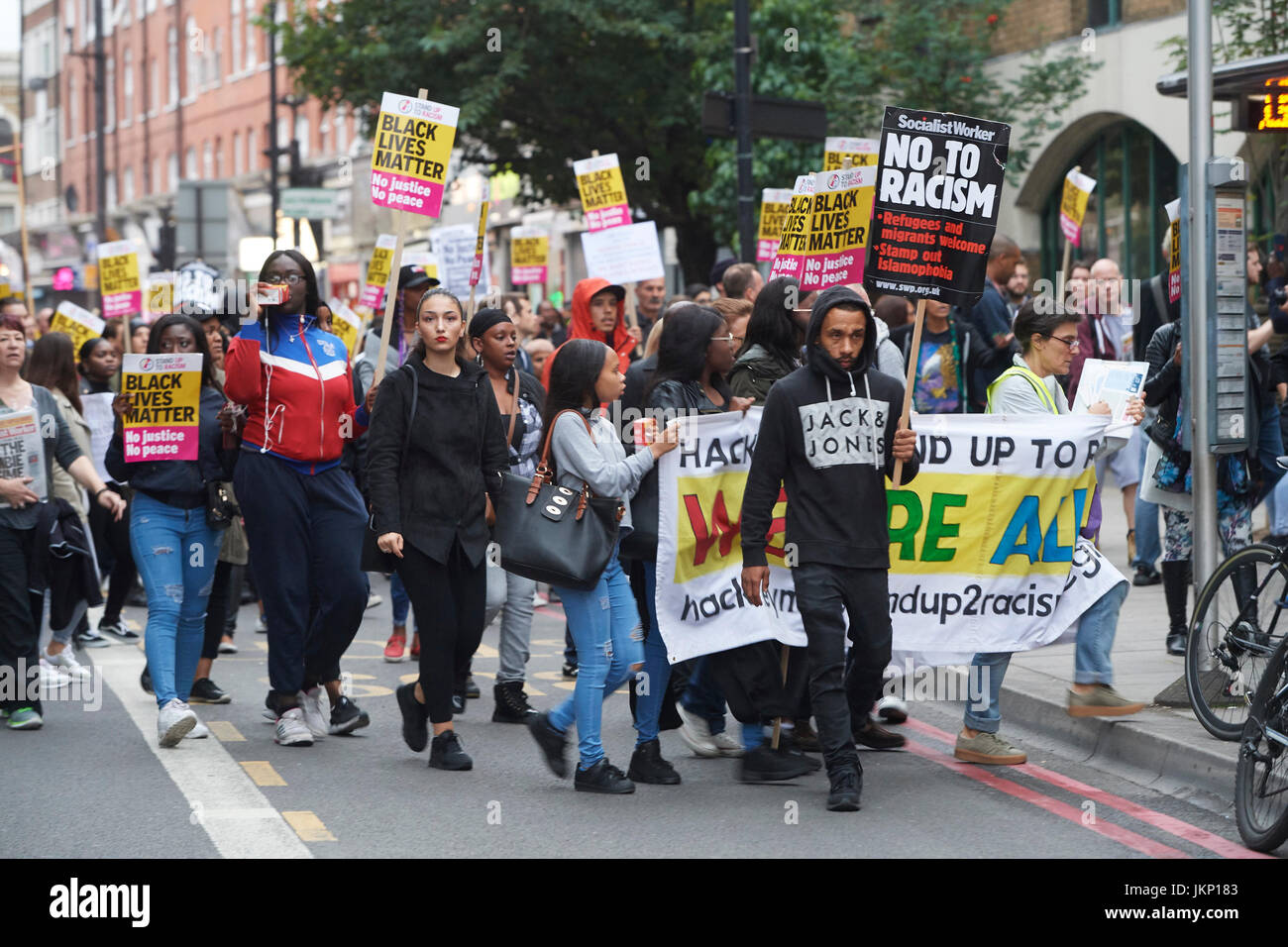 London, UK. 24th July 2017. Vigil for Rashan Charles outside Stoke newington police stationPeaceful protesters march - Stock Image