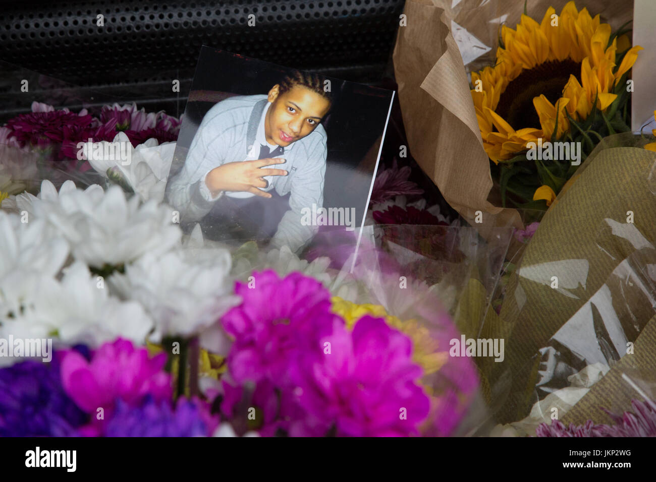 London, UK. 24th July, 2017. Floral tributes for Rashan Charles who died after being chased and arrested by police - Stock Image