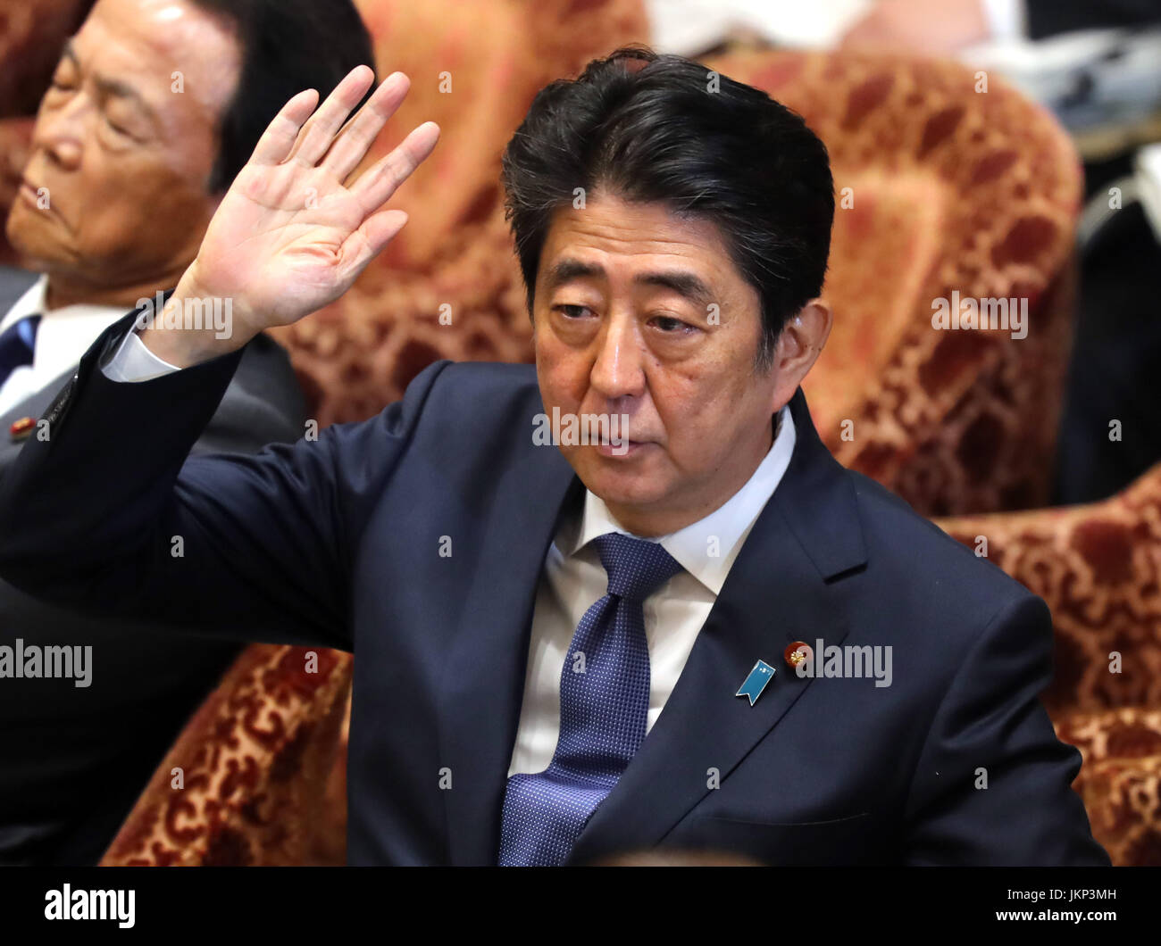 Tokyo, Japan. 24th July, 2017. Japanese Prime Minister Shinzo Abe raises his hand to answer a question by an opposition - Stock Image