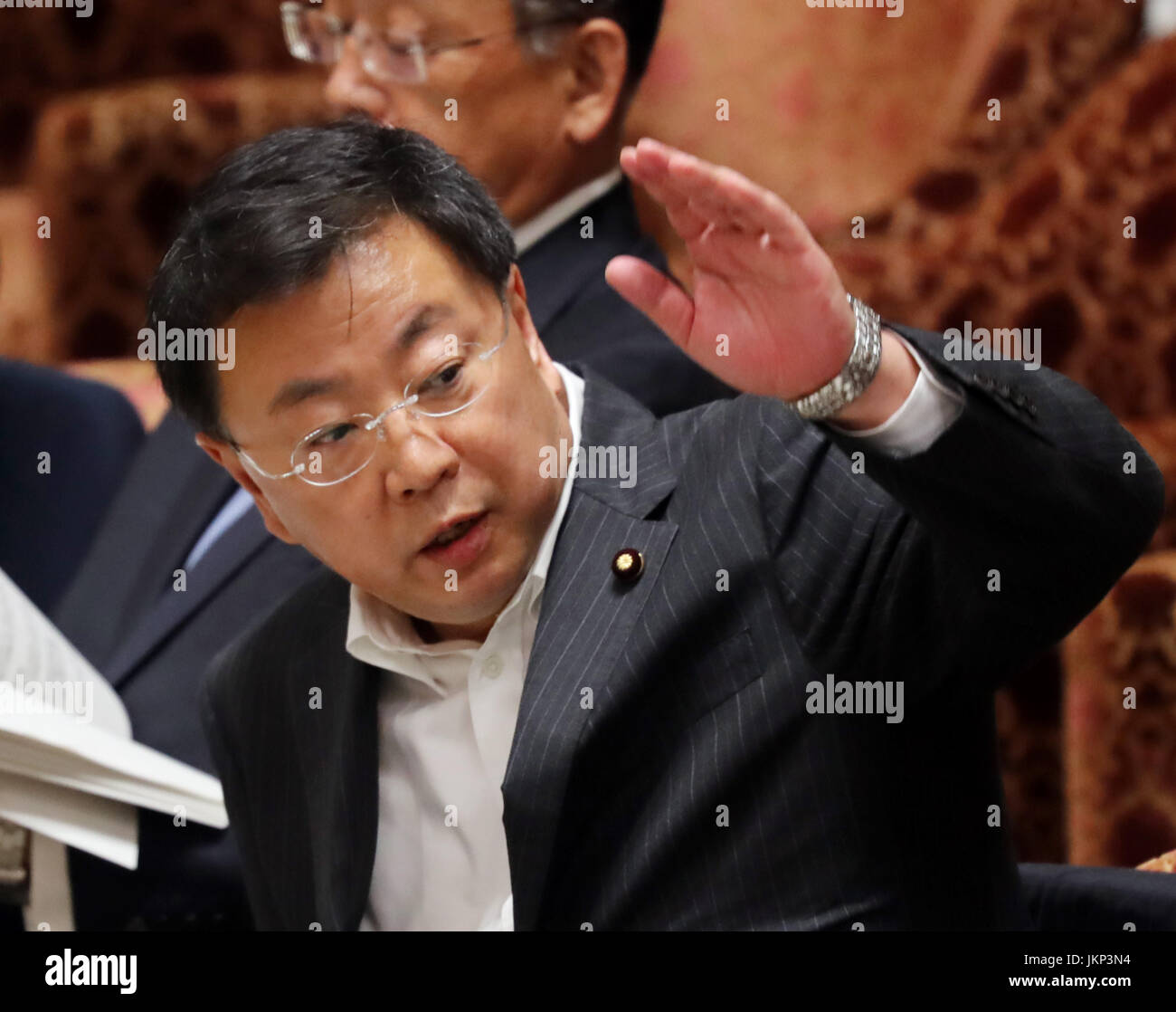 Tokyo, Japan. 24th July, 2017. Japanese Education Minister Hirokazu Matsuno raises his hand to answer a question - Stock Image